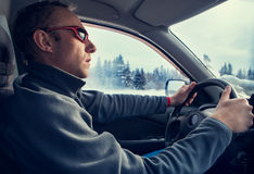 Winter driver inside car view Stock Photos