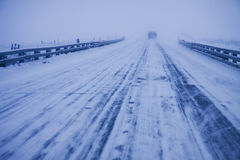 Winter driving. Icy, snow-packed winter roads show dangerous driving Royalty Free Stock Photo