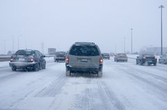Winter Driving. Cars on a high-way in a snow storm Stock Photo