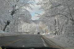 Winter Driving. View from car while driving on winter roads Stock Image