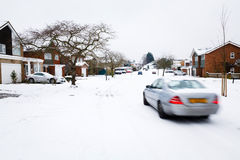 Winter driving. Car driving in winter snow on a road in England royalty free stock images