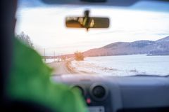 Man is driving on a dangerous icy road stock image