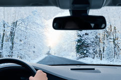 Winter driving - country road in winter Royalty Free Stock Photography