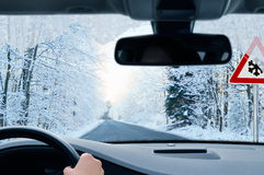 Winter driving - country road in winter Stock Images