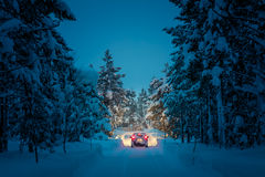 Winter Driving at night - Lights of car in snowy road Royalty Free Stock Photography
