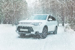Winter driving. Off-road riding on winter forest snowy road Stock Photos