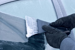 Winter driving - scraping ice from a car window Stock Images