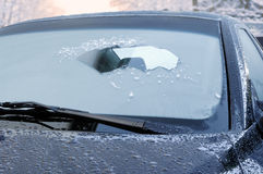 Winter driving - scraping ice from a windshield Stock Photos