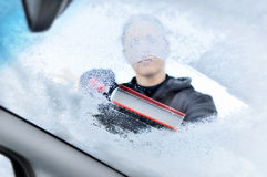Winter driving - scraping ice from a windshield Stock Image