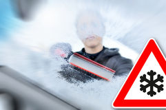 Winter driving - scraping ice from a windshield Stock Photography