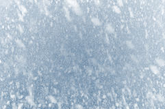 Winter Driving - Snow on an ice covered windshield Royalty Free Stock Image