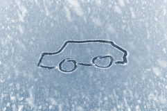 Winter Driving - Snow on an ice covered windshield with sketched car Stock Image