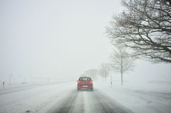 Winter driving by snowstorm Royalty Free Stock Image