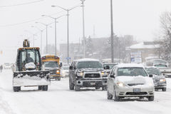 Winter driving in Toronto. TORONTO, CANADA - FEBRUARY 5, 2014: Traffic on Kingston Road during winter snowstorm on Wednesday, February 5, 2014 in Toronto royalty free stock photography