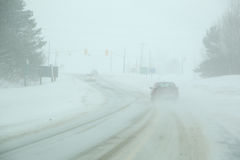Winter Driving. Two cars driving in a snow storm in Ontario, Canada. The cars can barely be seen Royalty Free Stock Image