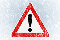 Winter driving - winter background with warning si Royalty Free Stock Image