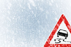 Winter driving - winter background with warning sign Stock Images