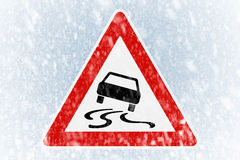 Winter driving - winter background with warning sign Stock Photo