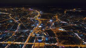Winter drone shot Minsk city in the night residential and business buildings from above aerial