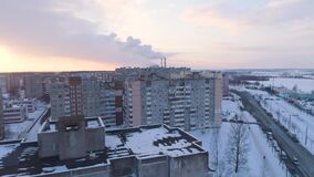 Winter drone shot of the Minsk city suburbs snow sunset residential buildings from above aerial. Streets stock video