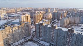Winter drone shot of the Minsk city suburbs snow sunset residential buildings from above aerial. Streets stock footage