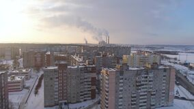 Winter drone shot of the Minsk city suburbs snow sunset residential buildings from above aerial. Streets stock video footage