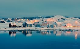 Winter Dusk in Durrell of Twillingate NL Canada. Calm winter evening in Durrell Harbour neighbourhood of outport town of Twillingate, Newfoundland, NL, Canada stock photos