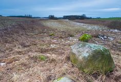 Winter or early spring landscape of boulder stones on fields Stock Photo