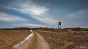 Winter or early spring landscape of field with raised hide Royalty Free Stock Images