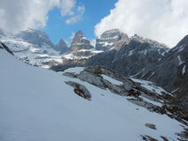 Winter and early spring in snow covered dolomites Stock Photos