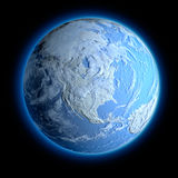 Winter Earth. Exaggerated metaphor for the winter Earth, when all the continents are covered with snow stock illustration