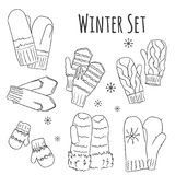 Winter eingestellt mit handdrawn Handschuhen in den Linien Stockfotos