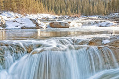 Winter at Elbow Falls. Elbow Falls in winter with golden light Royalty Free Stock Photos