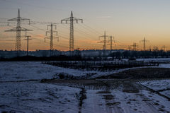 Winter electric power lines steel tower landscape Snow white sunset sunrise dawn 3 Stock Photography