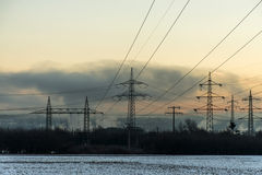 Winter electric power tower landscape Snow white sunset sunrise dawn Stock Photos