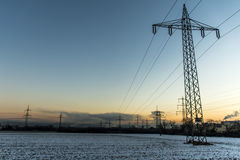 Winter electric power tower landscape Snow white sunset sunrise dawn Stock Image