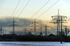 Winter electric power tower landscape Snow white sunset sunrise dawn Stock Images