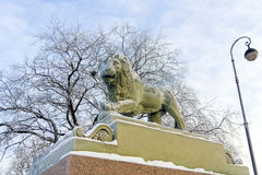 Winter embankment of the Neva River, snow lion statues Royalty Free Stock Photography
