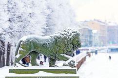 Winter embankment of the Neva River, snow lion statues Stock Photos