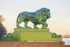 Winter embankment of the Neva River, snow lion statues.  royalty free stock photos