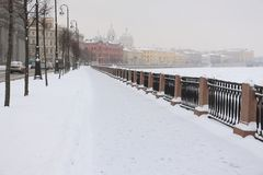 Winter embankment, swept up by snow. Winter city embankment, swept up by snow Stock Image