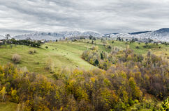 Winter embraces autumn. Two seasons over the Bran hills, Romania Royalty Free Stock Photography