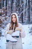 Winter emotion. Outdoor portrait of young pretty beautiful woman in cold sunny winter weather in park. Portrait of a stock photography
