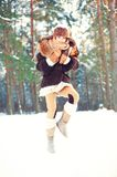 Winter enjoyment.Cheerful girl having fun in forest. Winter enjoyment. Cheerful girl having fun in forest. Outdoors. Filtered image Royalty Free Stock Image