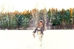 Winter enjoyment. Glad girl having fun in forest. Filtered image. Winter enjoyment. Glad girl having fun in forest. Outdoors. Filtered image Royalty Free Stock Photo