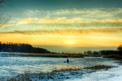 Winter evening. In countryside landscape. HDR image Royalty Free Stock Photo