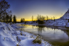 Winter evening. On the creek Royalty Free Stock Images