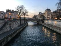 Winter evening along the Seine River in Paris Stock Images