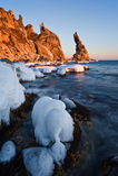 Winter evening at Cape Laplace. Stock Photos