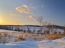 Winter evening on hills Stock Photo